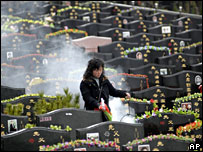 A woman walks through a cemetery in Nanjing, eastern China (archive picture)