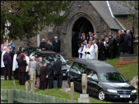 Mourners arrive at St Fagan's Church