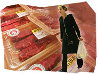 Woman and meat in a supermarket