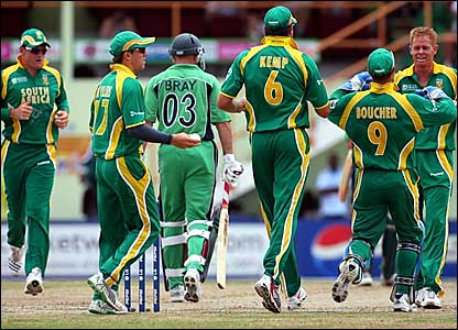 South Africa's Shaun Pollock (right) is congratulated after removing Jeremy Bray (centre)