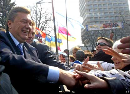 Mr Yanukovych greets his supporters during a rally in Kiev.