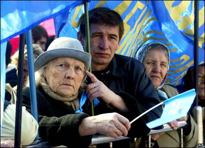 Yanukovych supporters listen to their leader during a rally in Kiev.