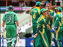 Shaun Pollock, second right, celebrates the wicket of Jeremy Bray