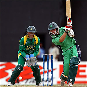 Ireland's Andrew White hits a shot through the covers