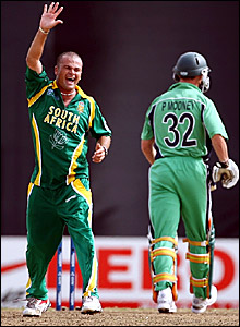 Charl Langeveldt (left) celebrates taking the wicket of Paul Mooney