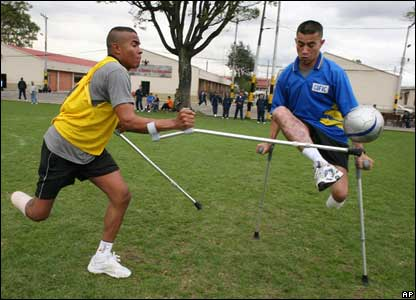 Soldiers who lost their limbs due to landmines play football at a military base in Bogota, Colombia.