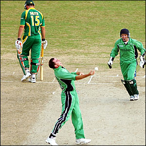 Ireland skipper Trent Johnston (centre) celebrates taking the wicket of Graeme Smith (left)