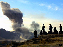Northern Alliance fighters watch air strike on Afghanistan