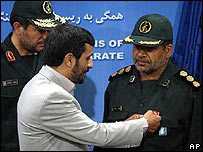 Iranian President Mahmoud Ahmadinejad awards medals to coast guard commanders