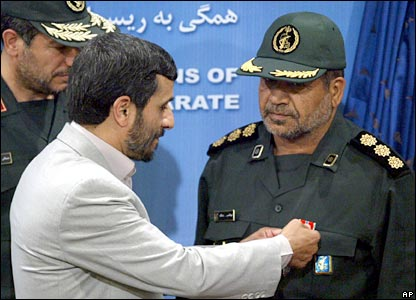 Iranian President Mahmoud Ahmadinejad gives medals to commanders who captured sailors