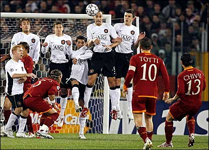 Cristian Chivu curls a free-kick over the Manchester United wall