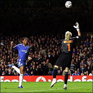 Didier Drogba (left) heads in Chelsea's equaliser over Valencia keeper Santiago Canizares