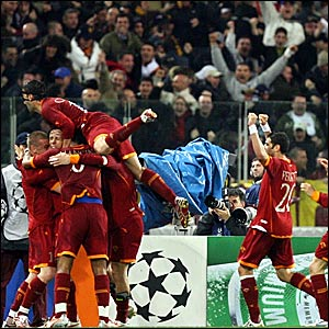 Roma players celebrate scoring the opening goal against Manchester United