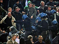 Manchester United fans and police clashed during the game