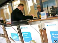Interior of Barclays Bank, also showing loan leaflets