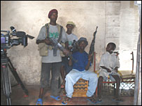 Boys play the role of soldiers for the camera