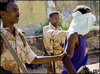An detainee suspected of spying for the Islamists is led away by government soldiers in Somalia (File picture from December 2006)