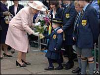 The Queen receiving flowers outside the cathedral