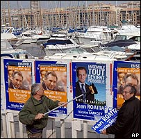 Sarkozy supporters putting up election posters in Marseille