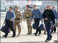 Captured crew arriving in the UK