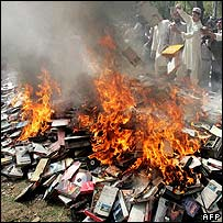 Supporters of Maulana Aziz burn videos and CDs