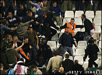 Tottenham fans and police in Seville