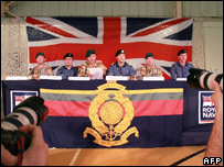 The released navy crew at the press conference