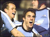 Thom Evans celebrates scoring Glasgow's third try