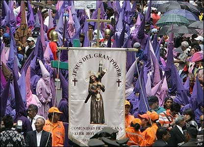 Penitents of 'Cucuruchos' brotherhood march in Quito, Ecuador.