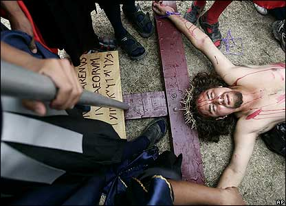 An unidentified actor dressed as Christ re-enacts the crucifixion in Honduras