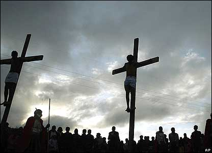 Three men hang on crosses on a hill above La Paz