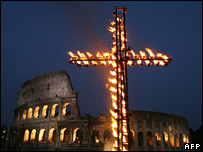 A giant cross is lighted in front of the Colosseum on 6 April 2007