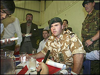 Royal Marine Captain Chris Air addressing reporters