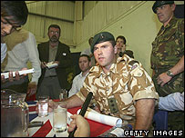 Royal Marine comrade Captain Chris Air addressing reporters
