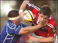 Llanelli Scarlets centre Gavin Evans breaks through the Borders defence