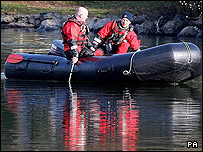 Searchers in a dinghy