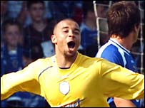 Deon Burton celebrates Sheffield Wednesday's winner against Cardiff