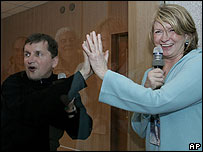 Charles Simonyi and Martha Stewart with a glass wall between them, during a farewell ceremony