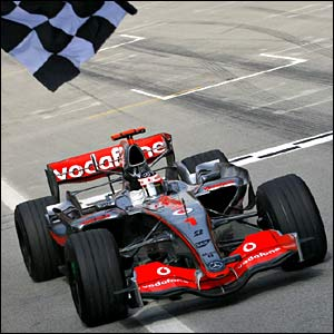 Fernando Alonso celebrates victory in the Malaysian GP