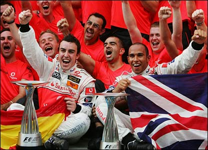Fernando Alonso and Lewis Hamilton with the McLaren team