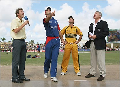 Michael Vaughan conducts the toss