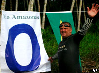 Martin Strel celebrates next to a banner that marks the point zero of the Amazon River near the city of Ponta de Pedras on Saturday.