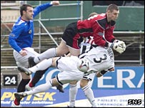 Kirk Broadfoot collides with Chris Smith for Rangers' goal