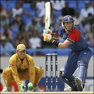 Pietersen prepares to play a shot as Adam Gilchrist watches