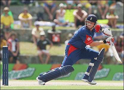 Bell watches as he sends a ball towards the boundary