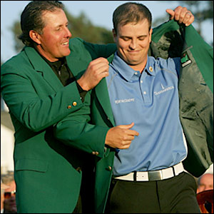 Zach Johnson (right) receives the winner's Green Jacket from 2006 champion Phil Mickelson