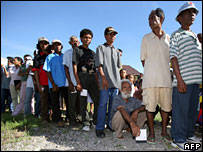 Voters line up at a polling station in Dili