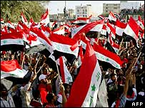 Shias wave Iraqi flags in Najaf