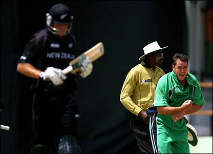Ireland's Dave Langford-Smith celebrates the wicket of Hamish Marshall