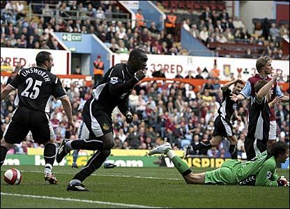Emile Heskey (left) wheels away to celebrate his goal against Aston Villa